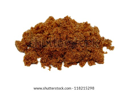 Pile of dark brown soft sugar, isolated on a white background - stock photo