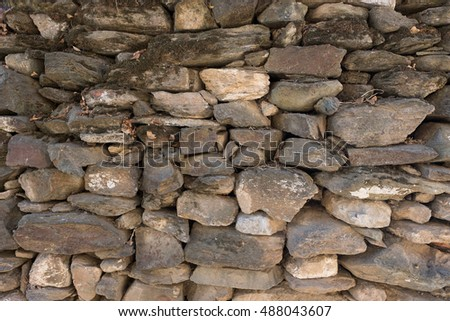 Pile of dark stone wall texture