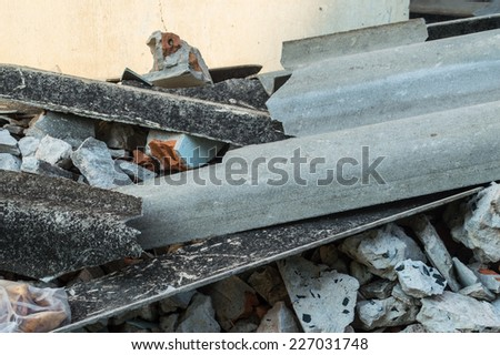 Pile of debris of a ruined building - stock photo