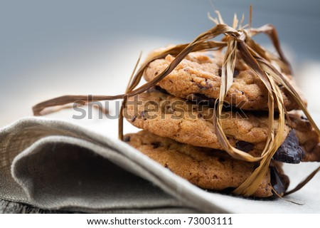 Pile of delicious chocolate chip cookies on table - stock photo