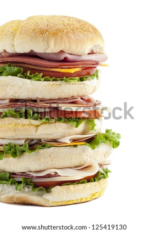 Pile of delicious ham sandwiches isolated in a white background