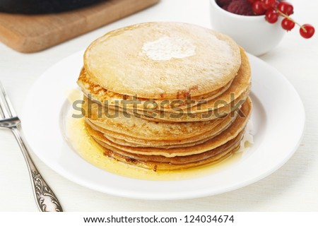 Pile of delicious handmade pancakes on table