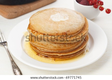 Pile of delicious handmade pancakes on white background
