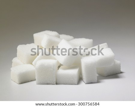 pile of delicious white lumps of cubes sugar - stock photo