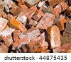 Pile of demolished brick wall and concrete debris - stock photo