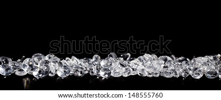 Pile of diamonds on a black background close up