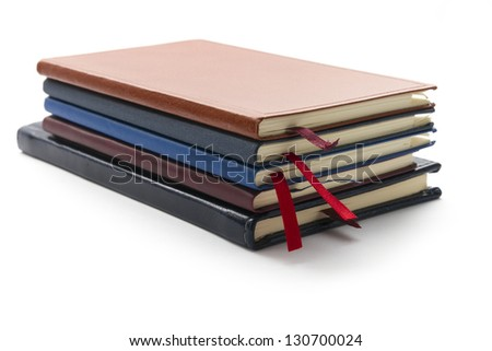 pile of diary calendar isolated on white background - stock photo