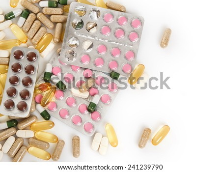 Pile of different colorful pills - stock photo
