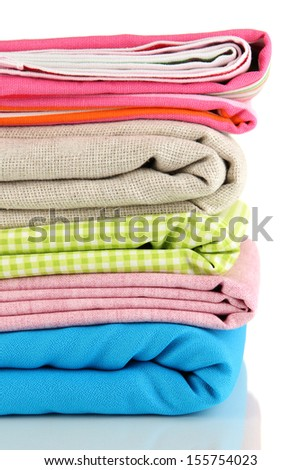 Pile of different fabrics isolated on white