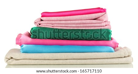 Pile of different fabrics isolated on white - stock photo