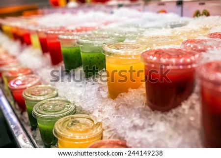 Pile of different fresh squeezed juices - stock photo