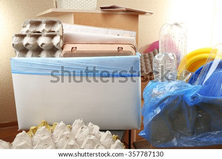 Pile of different waste, indoors. Waste sorting concept - stock photo