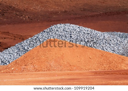 Pile of dirt and gravel on a construction site - stock photo
