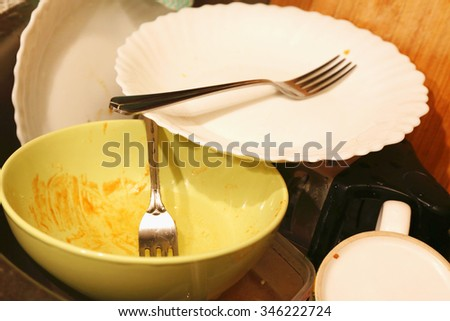 Pile of dirty dishes  in the sink - stock photo