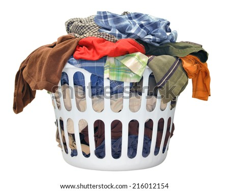 Pile of dirty laundry in a washing basket on a white background - stock photo