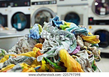 Pile of dirty laundry in laundrette - stock photo