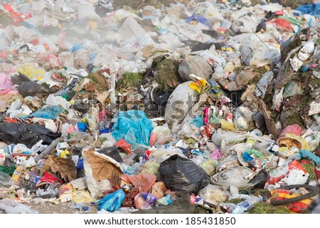 Pile of diverse domestic garbage in landfill  - stock photo
