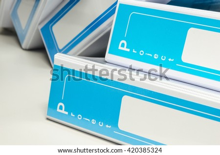 pile of document binder stacked on desk - stock photo