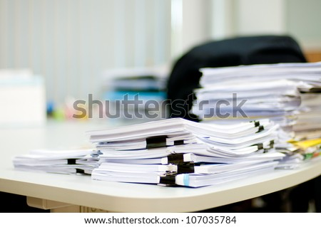 pile of document on desk