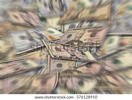 Pile of dollar banknotes in different currency 5, 10, 50, 100 dollar currency of the United States useful as a background with zoom effect