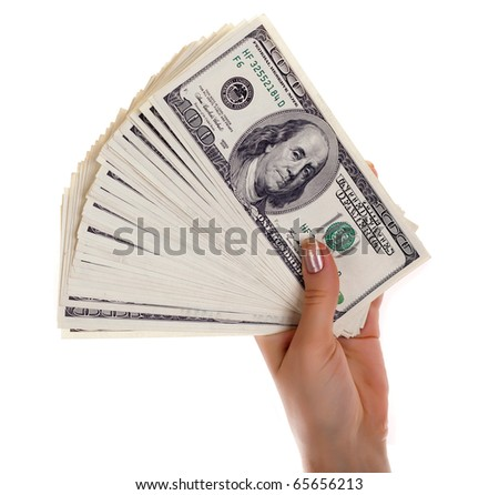 Pile of dollar s banknotes in female hand on white background - stock photo