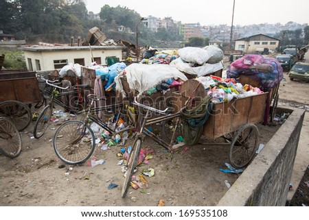 Pile of domestic garbage in carts, bicycles. Asian landfills. - stock photo