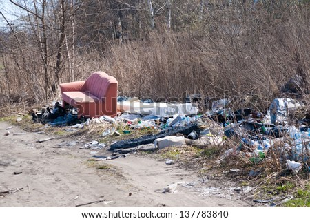 Pile of domestic garbage near the country road - stock photo