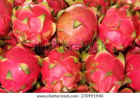 Pile of dragon fruits for sale at market - stock photo