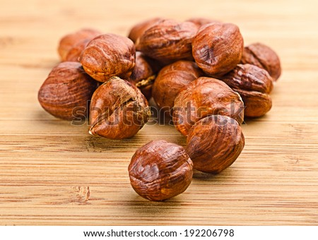 Pile of dried hazelnuts . Images collected from four shots to increase the zone of sharpness - stock photo