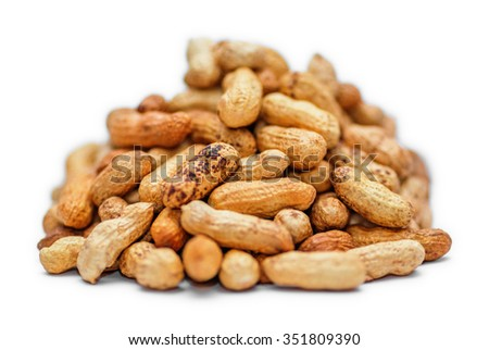 Pile of dried peanuts on white background - stock photo
