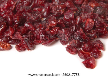Pile of dried red cranberries on a white background - stock photo