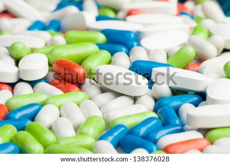 Pile of drugs, many different pills and tablets - stock photo