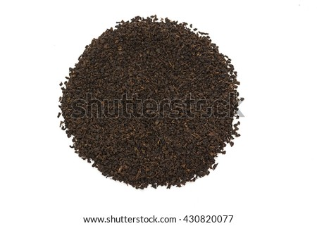 Pile of Dry black tea leaves, on white background