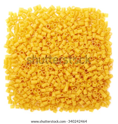 Pile of dry ditalini yellow pasta over isolated white background - stock photo