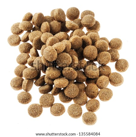 Pile of dry dog food isolated on white background, seen from directly above. - stock photo
