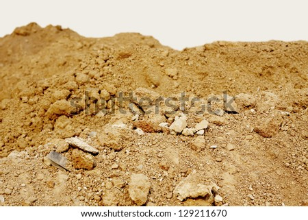 Pile of dry soil at construction site.