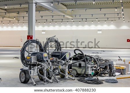 "Pile of equipment for professional airless spray, after job is done. Shopping center ""AVIV PARK"" in Zrenjanin, Vojvodina, Serbia, 11.09.2015. - stock photo"