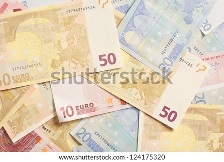 Pile of Euro bills in different denominations for spending - stock photo