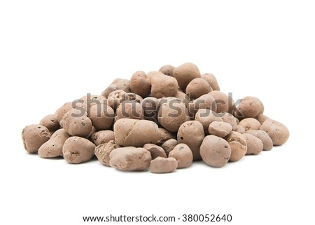 Pile of expanded clay drainage isolated on white - stock photo