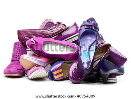 Pile of female violet shoes isolated on white background - stock photo