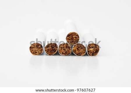 Pile of few unlighted tobacco cigarettes