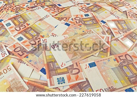 Pile of fifty euro banknotes as seamless background for financial and economy themes. - stock photo