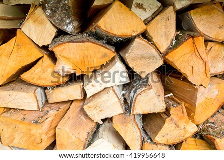 Pile of firewood, Chopped firewood, stacked and ready for winter. - stock photo
