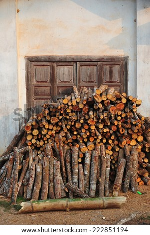 Pile of firewood front the window - stock photo