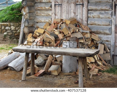 Pile of firewood next to hut cabin in mountain alps . Alpe di Siusi, South Tyrol - Italy - stock photo