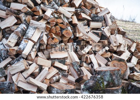 Pile of firewood. Preparation of firewood for the winter. - stock photo
