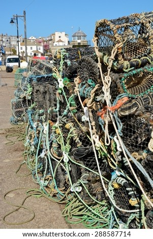 Pile of fishing nets and pots on harbour side at Saint Ives, Cornwall, England - stock photo