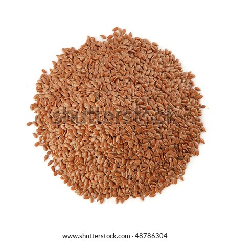 Pile of flax seeds isolated on white - stock photo