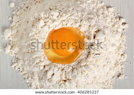 Pile of flour with egg on top