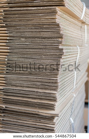 Pile of folded corrugated cardboard